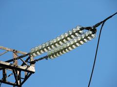 Insulators of a power transmission tower Stock Photos