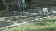 Stock Video Footage of Worker Repairing Sidewalk with Cement, Worker Putting Cement Making Steps