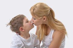 portrait of happy mother and son - stock photo
