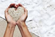 Heart shaping female hands Stock Photos