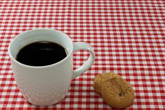 Coffee and biscuits on a tablecloth Stock Photos