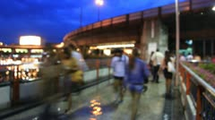 Sidewalk on the bridge in the town was packed with people walking back in the ev Stock Footage
