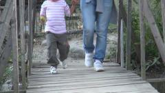 Child Stepping on a Wood Bridge, Woman Walking on a Bridge - stock footage