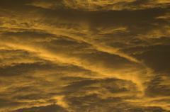 Clouds at sunrise Stock Photos