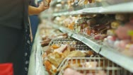 Customers select sausage delicatessen in supermarket Stock Footage