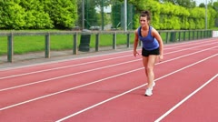 Women running relay race Stock Footage
