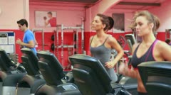 Three persons running on a treadmill Stock Footage