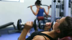 Woman lifitng weights Stock Footage