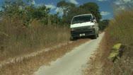 Van Rolls the road of African Bush Stock Footage