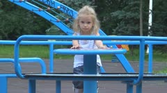 Playful Child at Playground in Park, Little Girl Shaking her Head Stock Footage