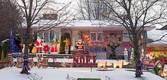 A bungalow decorated for the christmas season with santa, mrs. claus, gingerb Stock Photos