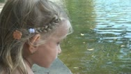 Stock Video Footage of Child Risking Falling Down in Water, Little Girl Playing near a Lake, Children