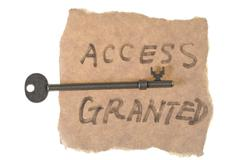 Old key and access granted words Stock Photos