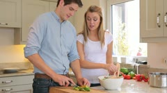 Couple preparing salad - stock footage
