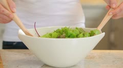Woman tossing salad Stock Footage