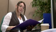 Stock Video Footage of Businesswoman checking files