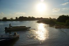 Boats on River in Botswana - stock photo