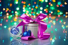 christmas decorations composition with fancy box on snowflake shaped bokeh ba - stock photo