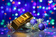 new year decorations composition with golden fancy box on bokeh background - stock photo