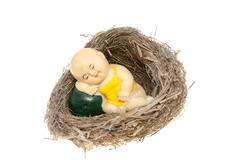 clay figurine in bird nest - stock photo