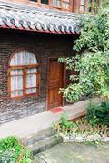 yard of a traditional naxi inn - stock photo