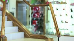 Woman going downstairs in shopping mall Stock Footage