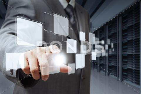 Stock Illustration of businessman pushing virtual buttons and server room background