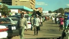 Crowds walk down African Street Stock Footage