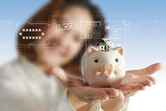 Stock Illustration of businesswoman as smart investment