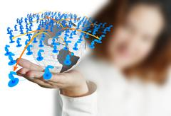 businesswoman hand holds globe and social network - stock illustration