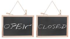 open and closed words on blackboard - stock photo