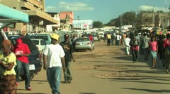 Crowds filter through African Market - stock footage