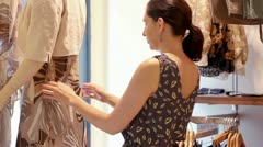 Woman dressing mannequin Stock Footage
