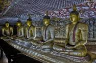 Stock Photo of Several Buddha Statues - Sri Lanka