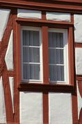 window on a half-timbered house - stock photo
