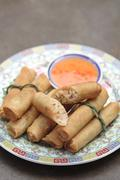 Asian spring rolls on plate Stock Photos