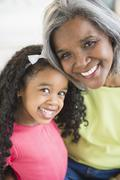 Smiling African American grandmother and granddaughter - stock photo