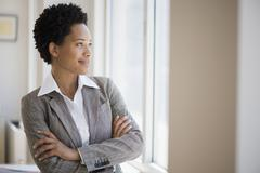 African American businesswoman with arms crossed Stock Photos