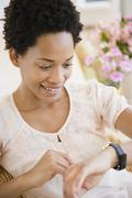 African American woman checking the time Stock Photos