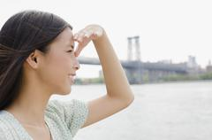 Asian woman looking at urban cityscape - stock photo