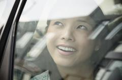 Asian woman riding in car Stock Photos