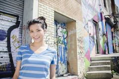 Asian woman near urban graffiti Stock Photos