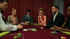 Dealer dealing poker cards and bets are being placed Stock Footage