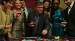 Man winning at craps - stock footage
