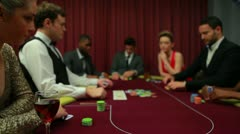 Two men left in poker game with everyone else folding Stock Footage