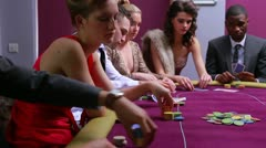 People at poker table placing bets woman in red dress going all in Stock Footage