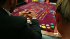 Woman talking to man at roulette table Stock Footage