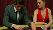 Stock Video Footage of Woman cheating at poker table