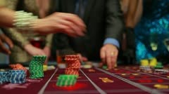 People placing their bets on roulette table Stock Footage
