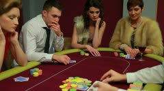 Four people playing poker and one is folding - stock footage